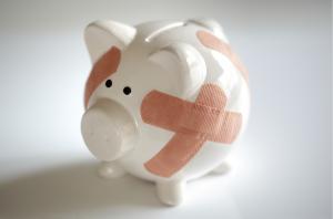 repaired piggy bank- debt relief help